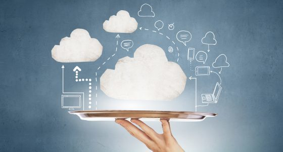 Human hand holding metal tray with cloud computing concept